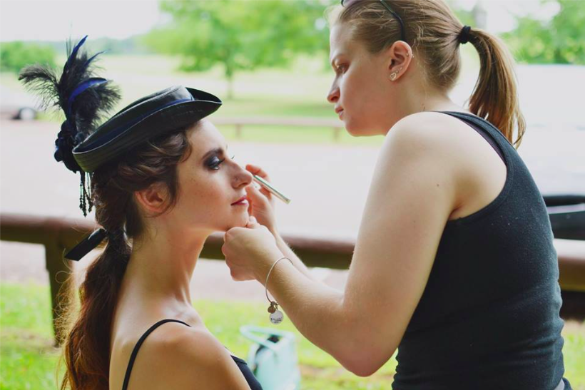 Lauren of LA Page Makeup working her magic behind the scenes at a photoshoot.