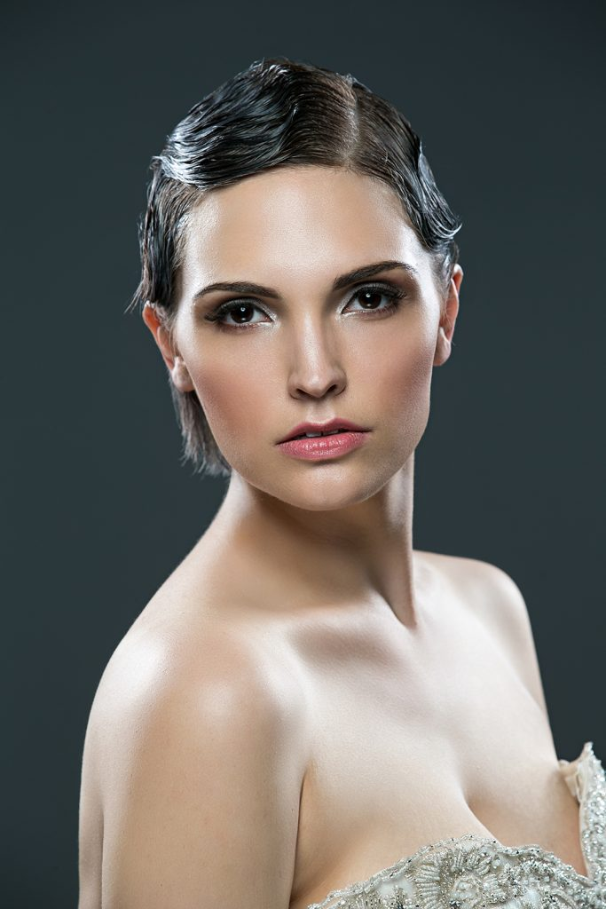 Sometimes a silver smokey eye can be appropriate for an evening wedding! It's daring and gorgeous!