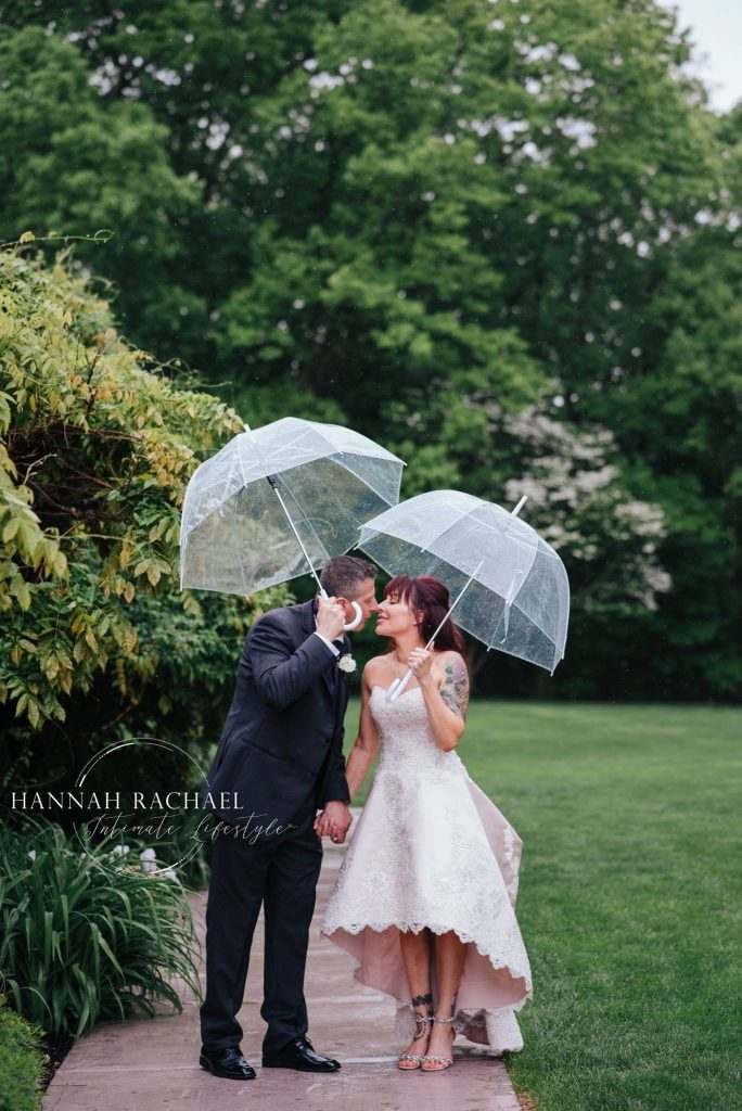 A little rain can't put a damper on this happy couple's wedding day at Saint Clements Castle in Portland, CT.