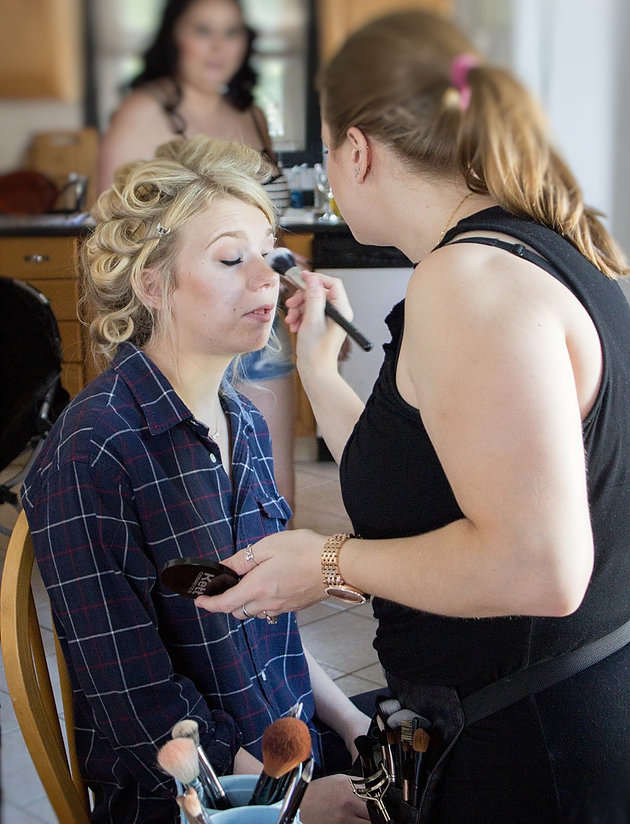 Behind the scenes shot of LA Page Makeup working on the bride's makeup!