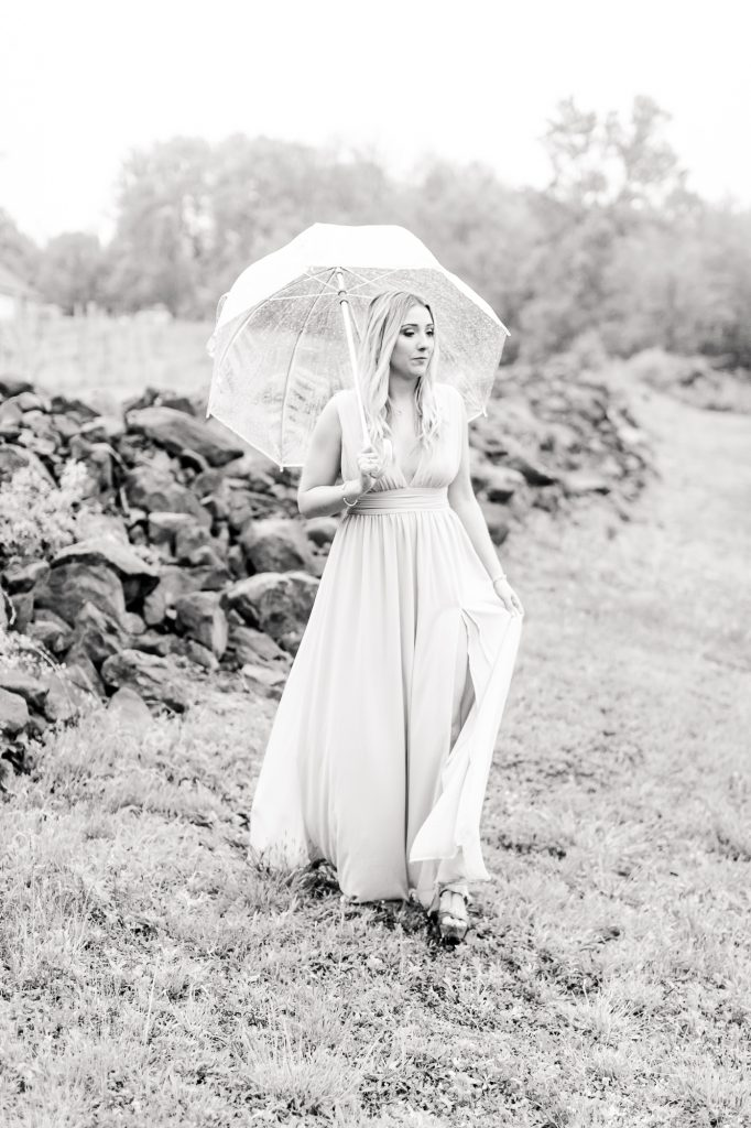 Beautiful black and white portrait of a rainy day engagement photoshoot at Paradise Hills Vineyard in Wallingford, CT.