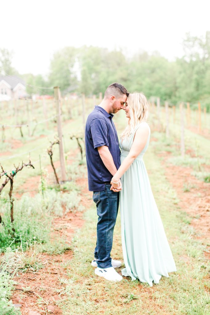 Loving moments exchanged for their engagement photoshoot at Paradise Hills Vineyard in Wallingford, CT.