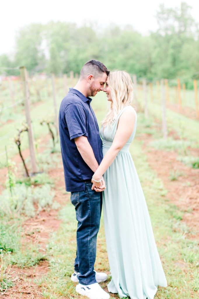 Loving looks for their engagement session at Paradise Hills Vineyard in Wallingford, CT.