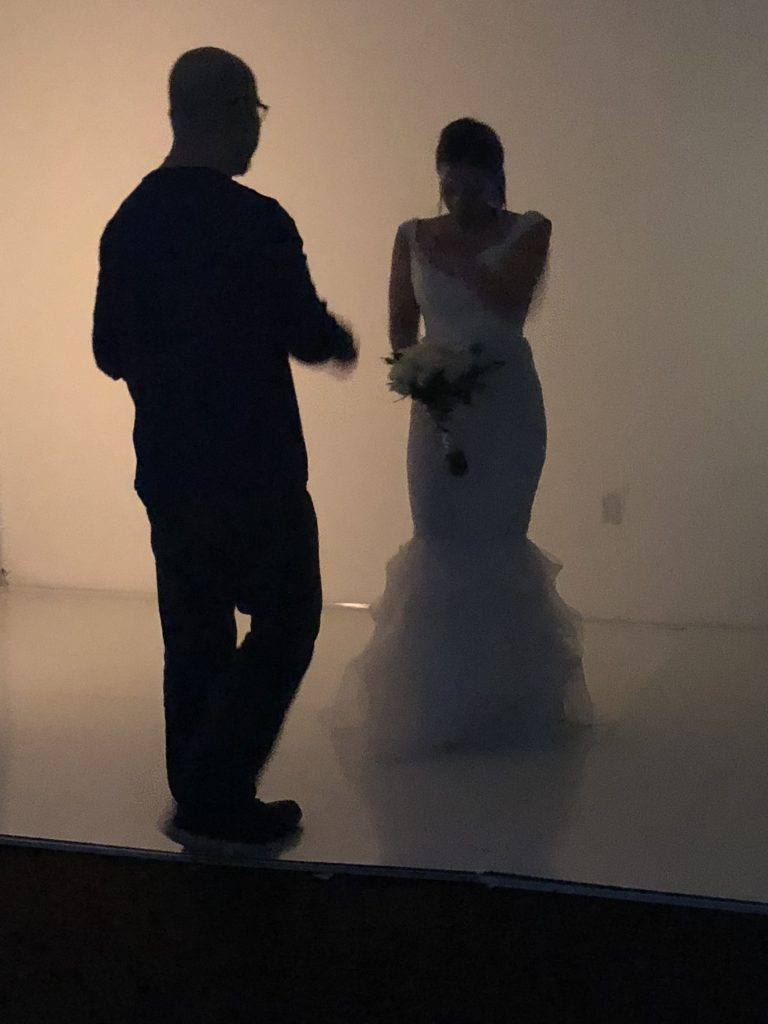 Photographer Watt works closely with one of the models on the set of a stylized bridal photoshoot.