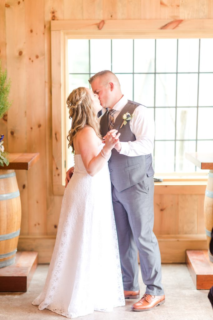 Sealed the deal with their first kiss as husband and wife at Chamard Vineyard in Cliton, CT.