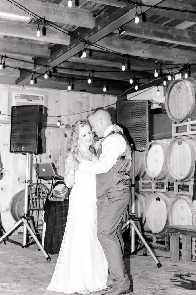 Whispering sweet nothings as new husband and wife at Chamard Vineyard in Cliton, CT.