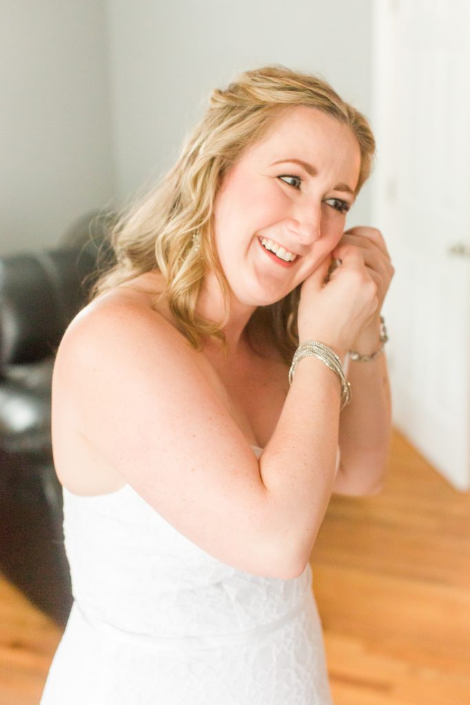 Carol happily putting on the finishing touches before her wedding at Chamard Vineyard in Cliton, CT.