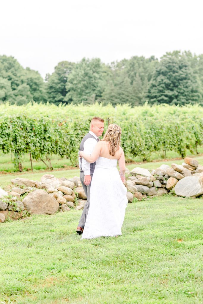 The first look from groom to bride always gets me! Taken at Chamard Vineyard in Cliton, CT.