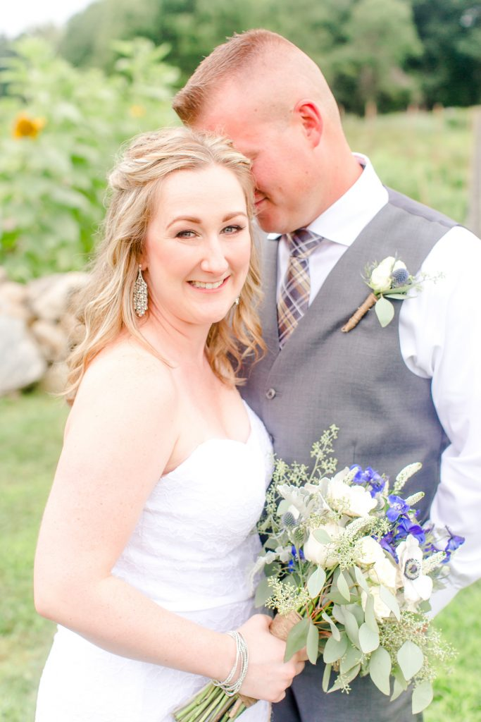 That looks like a very happy bride to me! Makeup by LA Page Makeup at Chamard Vineyard in Cliton, CT.