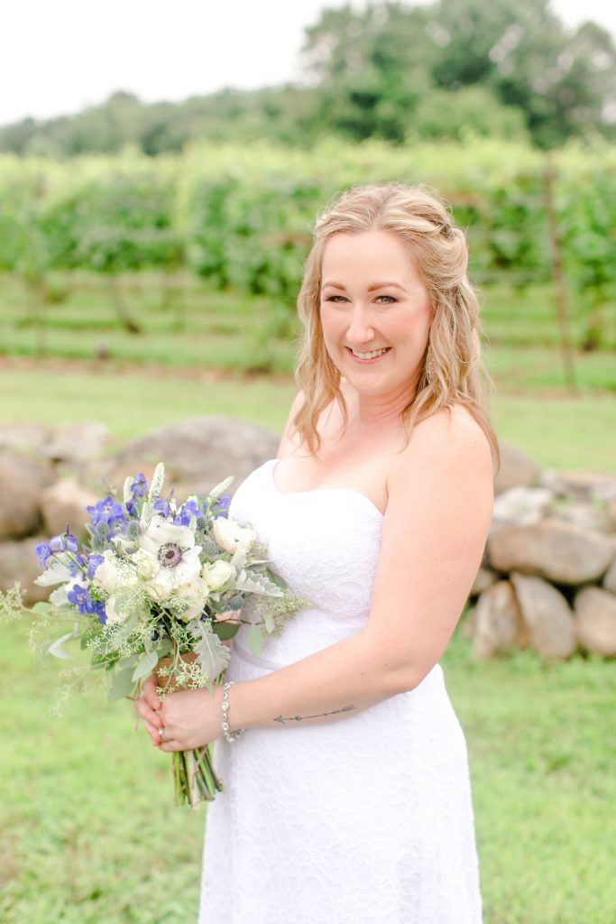Happy wife, happy life at Chamard Vineyard in Cliton, CT. Makeup by LA Page Makeup.