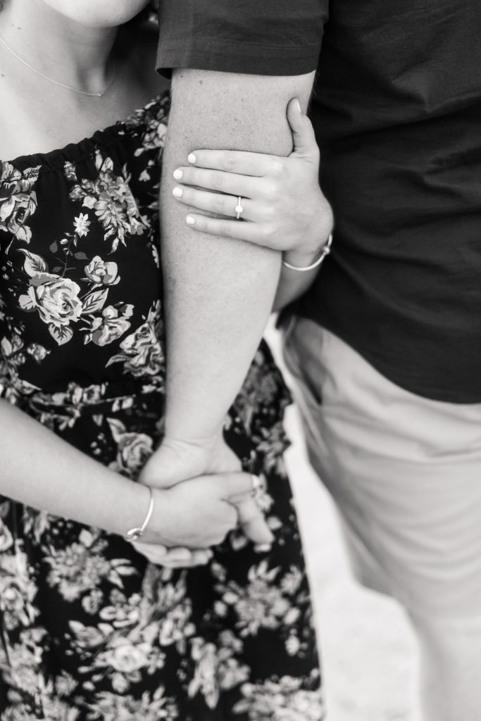 Black and white photos of a loving embrace surrounding the engagement ring make me swoon!