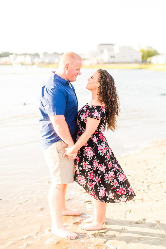 The look of love and adoration during their engagement session at Harvey's Beach in Old Saybrook, CT.