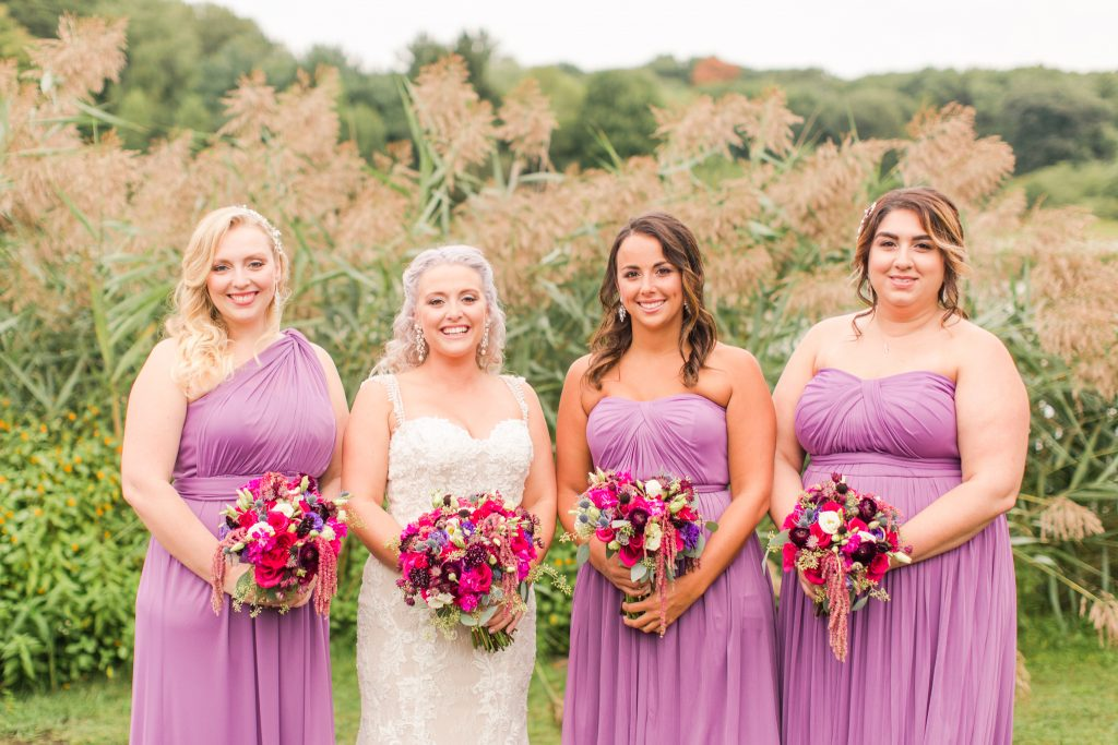 A beautiful bride and her gorgeous bridesmaids at The Lake House wedding in Wolcott, CT.