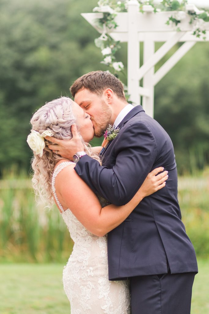 The kiss to pronounce them husband and wife at The Lake House wedding in Wolcott, CT.