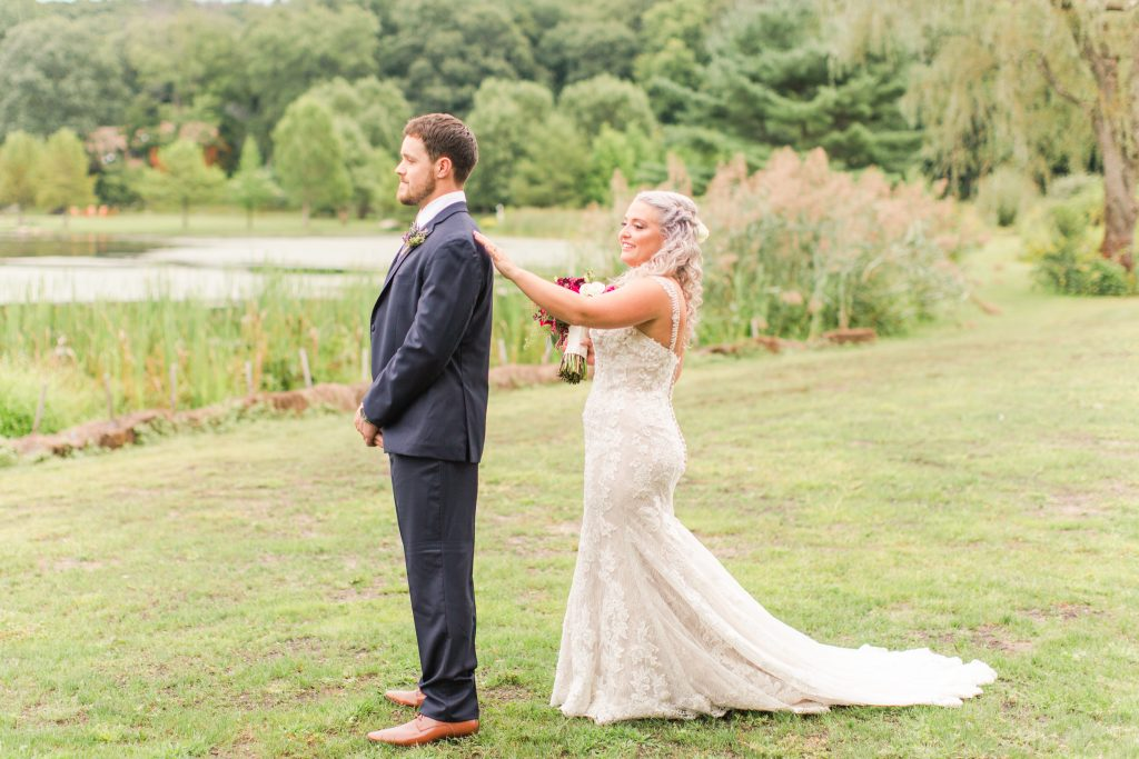 The final moment before the epic first look at The Lake House wedding in Wolcott, CT.