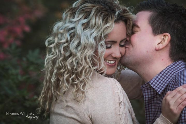 Gorgeous smile, amazing curls, sweet kiss, and flawless makeup. What more do you need for an AWESOME engagement session?