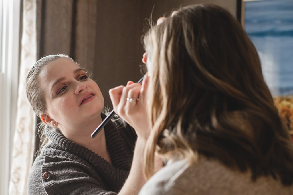 Lauren, owner of LA Page Makeup, behind the scenes creating the perfect bridal makeup look.