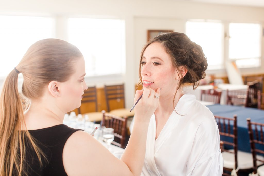 Behind the scenes putting on the final touches by Lauren from LA Page Makeup.