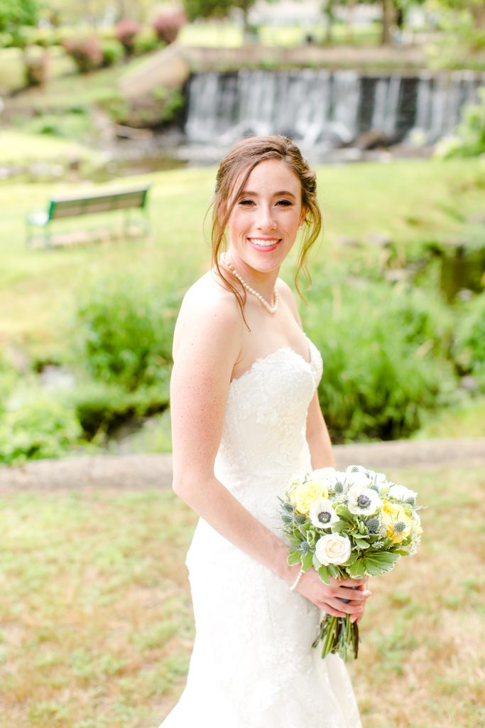 Flawless makeup, beautiful florals, gorgeous gown, and so much more to perfect Amy's wedding day look!