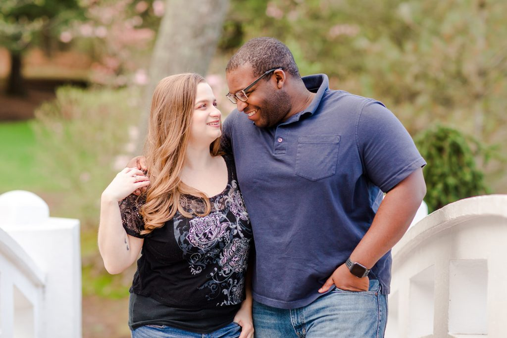 As I gaze into his eyes, he laughs! Funny shot during our engagement session at Wickham Park in Manchester, CT.