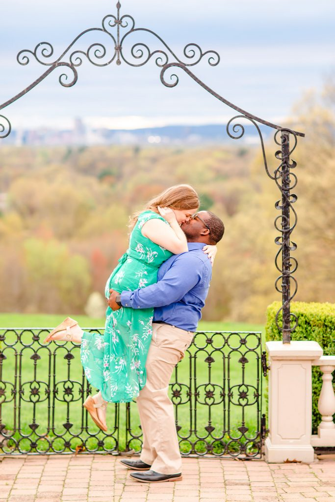 How romantic is this? Between the kiss, the lift, and the background, I'm in love! Taken at engagement session at Wickham Park in Manchester, CT.