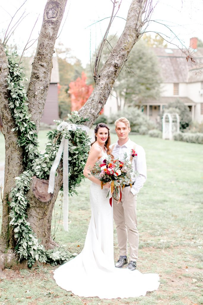The bride and groom had the idea to dress up this gorgeous tree and pose by it at they rustic barn wedding.