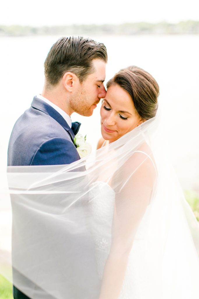 The veil. The makeup. The hair. The nuzzle. Everything about this wedding photo makes us swoon!