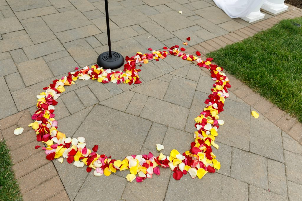 How adorable are these flower petals shaped as a heart where the ceremony will take place?!