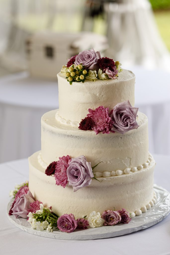 A simple cake with some beautiful flowers is the perfect accent to a wedding!