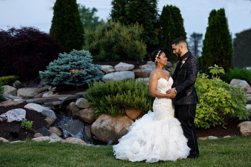 How beautiful is this bridal portrait with all the greenery in the background?!