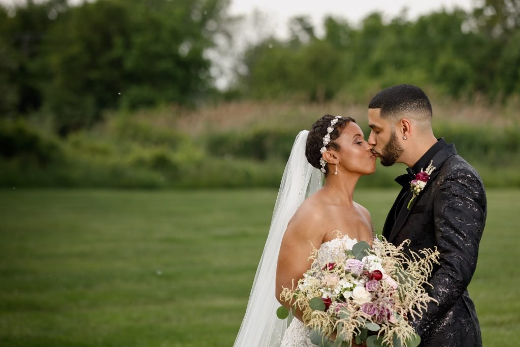 How adorable is the bride and groom trying to kiss without smudging her lipstick?! So precious.