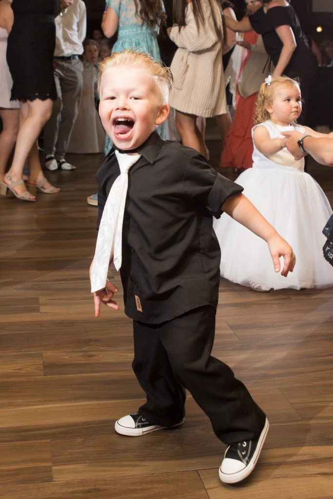 How adorable is their son getting down on the dance floor? He's so excited mommy and daddy are married!