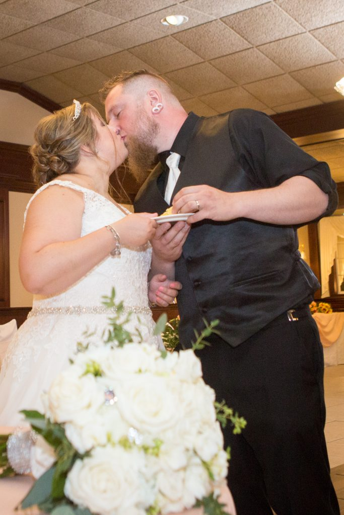 A romantic cake cutting - no throwing pies in the face, here!