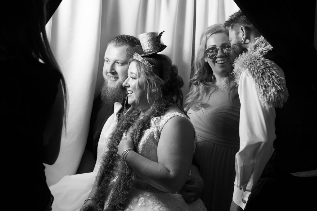 This candid picture of the newlyweds with some of their best friends in the photo booth is priceless - look at the love and happiness exuding from everyone!