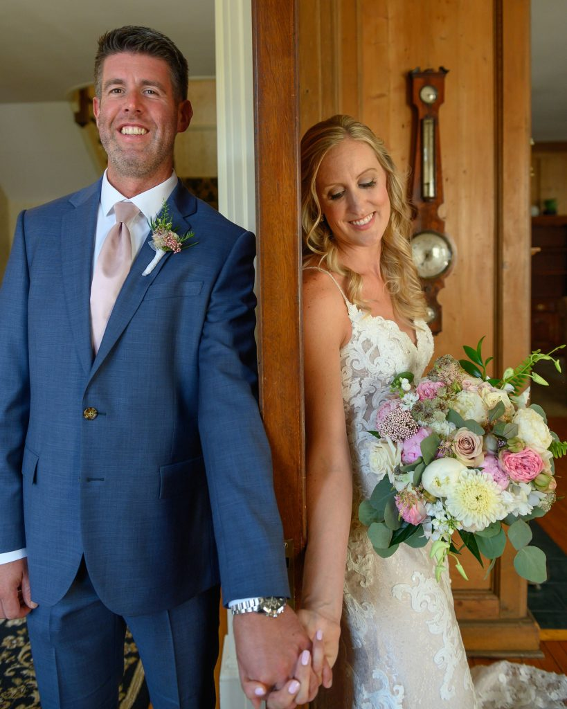 A first touch is the perfect thing to do before the ceremony if you don't want to see each other. Holding hands adds to the exciting emotions of the wedding day.