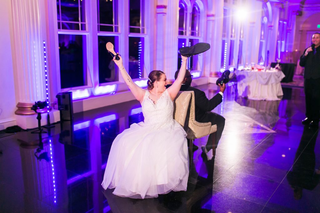 The newlywed couple plays the shoe game as the wedding dj asks silly questions at The Riverview in Simsbury, CT.