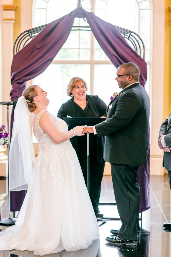A silly moment as the bride flubs the ring ceremony during the wedding ceremony with the justice of the peace at The Riverview in Simsbury, CT.
