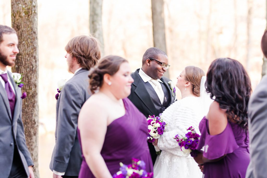 In a sea of people, this bride and groom pose as if they're the only ones in the room at The Riverview in Simsbury, CT.