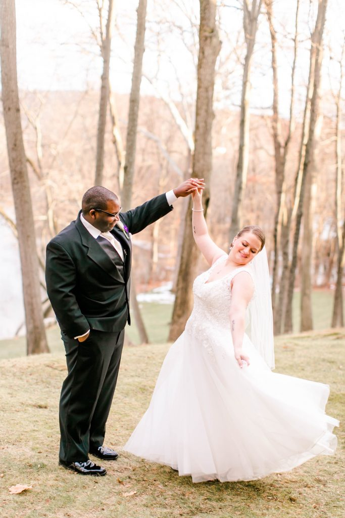 The bride and groom nail the perfect gown twirling shot for this wedding pictures at The Riverview in Simsbury, CT.