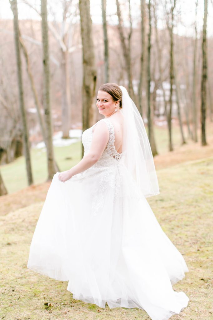 Beautiful, unique wedding dress, perfectly designed for short brides with lots of beading on the bodice at The Riverview in Simsbury, CT.