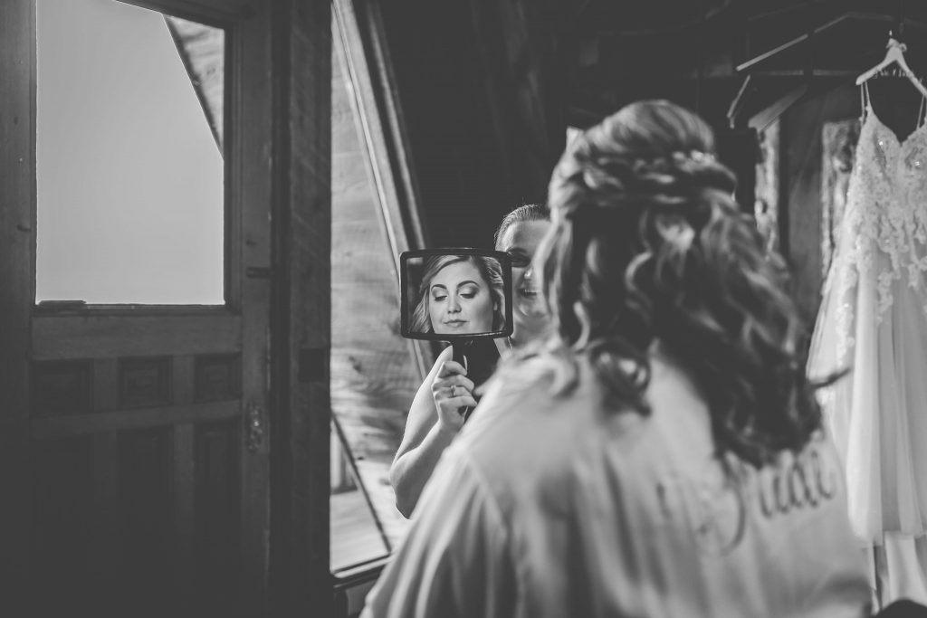 Rachel looked gorgeous showing off her wedding curly hair and natural wedding makeup for her getting ready wedding pictures at Bill Miller's Castle in Branford, CT.