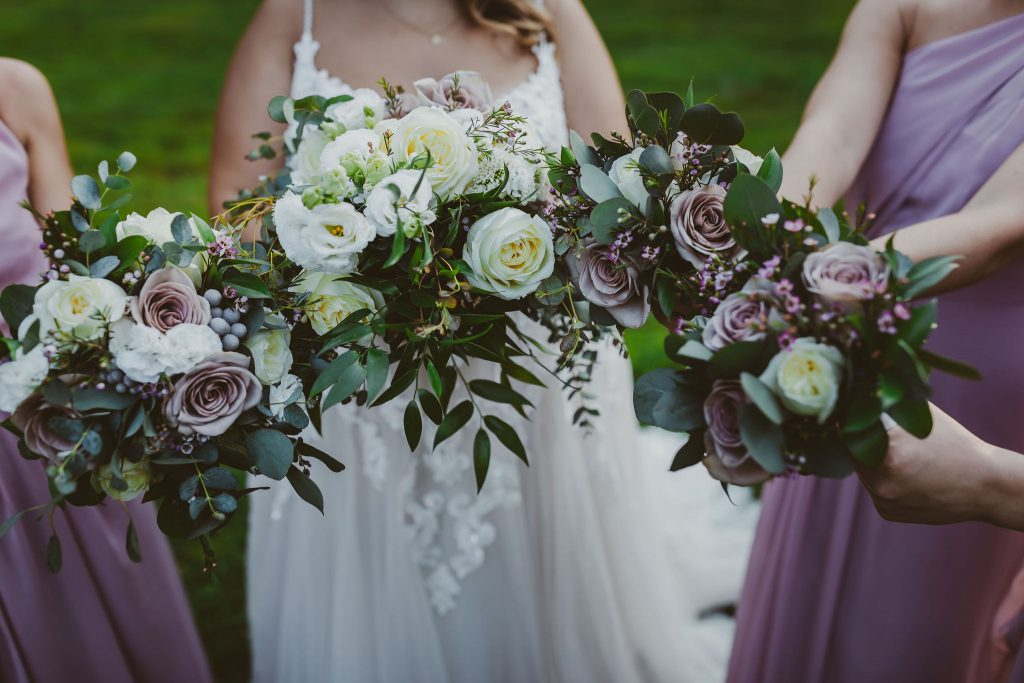 A beautiful display of the white and purple wedding flowers at Bill Miller's Castle in Branford, CT.