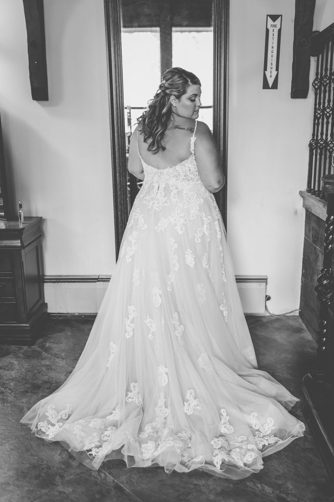 Look at the detail on this gorgeous, white, lacey wedding gown in this black and white wedding photo at Bill Miller's Castle in Branford, CT.