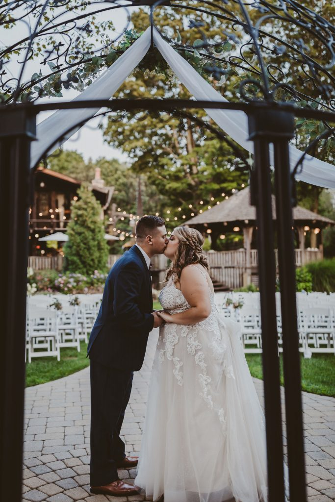 A unique shot of the first kiss as husband and wife wedding picture at Bill Miller's Castle in Branford, CT.