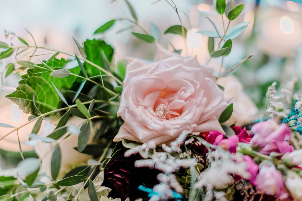 Johnna's wedding flowers included blush pink, dark purple, hot pink, and white colors to perfectly display her engagement ring at Tyrone Farm in Pomfret, CT.