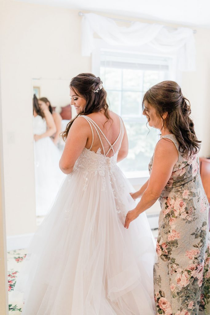 This was a special moment between Johnna and her mother while she finishes getting ready for her rustic wedding at Tyrone Farm in Pomfret, CT.