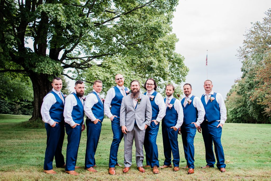 Jay and his groomsmen look stylish in their blue and grey suits at Tyrone Farm in Pomfret, CT.