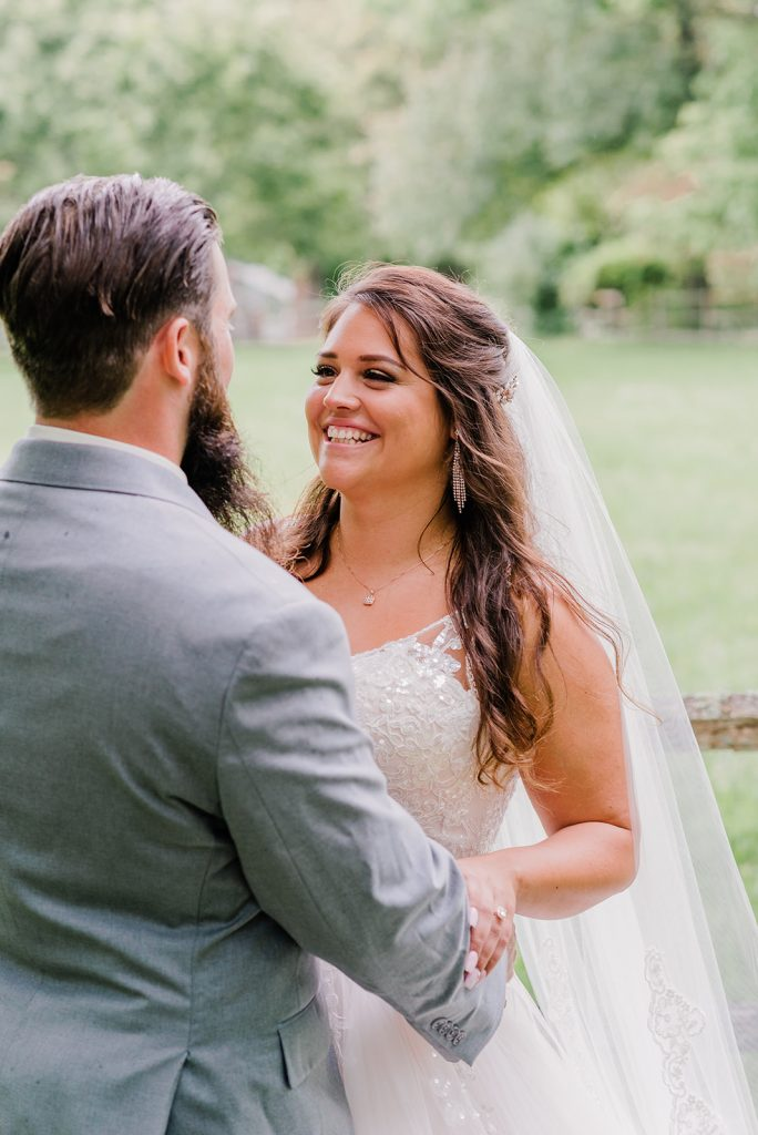 Johnna is all smiles as she sees her groom for the first time during their first look wedding photos at Tyrone Farm in Pomfret, CT.